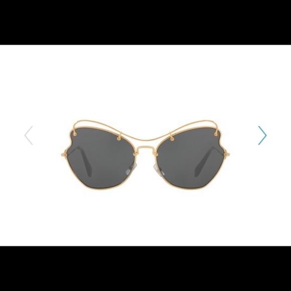 9ca7ccbcbdc Miu Miu Women s Butterfly 65 MM Sunglasses. M 5bd7aaacc617772a480e1132